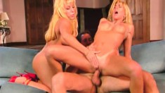 Lucky stud has two ravishing blondes sharing his big cock on the couch