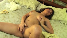 Sweet Tina Tai spreads her lovely body across the bed and masturbates