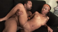 Ebony cutie with perfect boobs engages in hot sex with a black stud