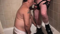 Chubby gay man drops to his knees and blows a big cock in the shower