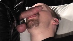 Gay Bear Rob Is On His Knees Sucking Off His Latex Clad Master