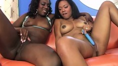 Sexy slender ebony lesbians reaching the peak of their climax together