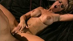 Buxom blonde spreads her legs to fully enjoy the pussy banging action