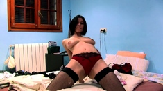 Busty milf rubs her pussy in a teddy and stockings